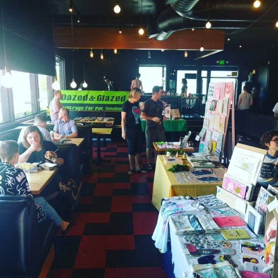 Inside the bar featured zines and art from Floating World Comics, Overcup Press Perfect Day Publishing, Propeller Books, Dazed and Glazed, Erika Rier Art, Lindsey Ann Watson, and Fruit Salad Club.